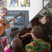 Guitarist Marco de Carvalho and pianist Marina Albero, performing at the Duvall House Concerts series on July 15, 2018